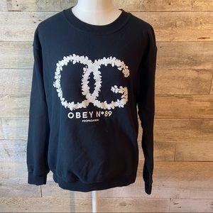 Obey women's black sweatshirt in size small